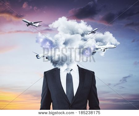 Cloud headed businessman with airplanes on sky background. Traveling concept