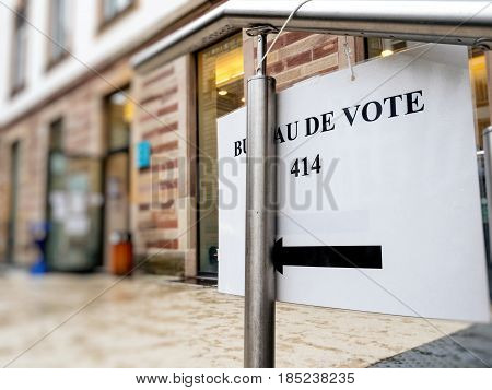 French city with sign to polling place during the second round of the French presidential election