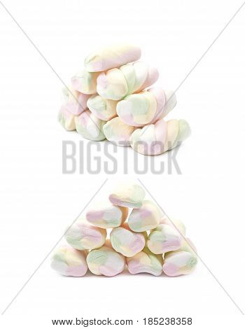 Pile of multiple colored marshmallow candies isolated over the white background, set of two different foreshortenings