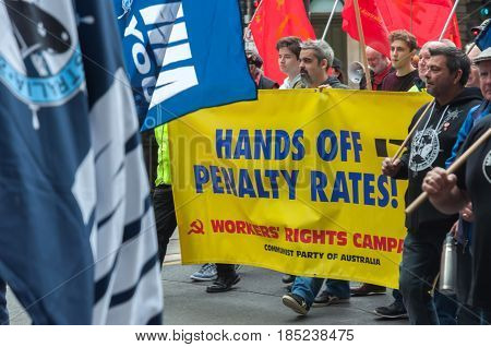 Adelaide, SA, Australia - May 6, 2017: Various members of the labour sector march in recognition of workers' rights and to protect working conditions.