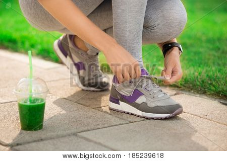 Young woman lace up snickers footwear sporty lifestyle