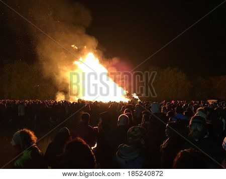 Lewes England - 5 November 2016: Crowd gathering around the great bonfire of the yearly celebration of the Bonfire night festivities.
