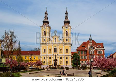 All Saints church in the center of the city in baroque style in Miskolc, Hungary.