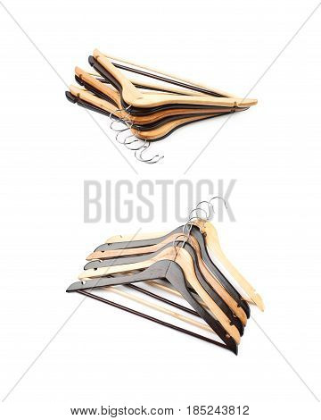 Pile of wooden hangers isolated over the white background, set of two different angles.