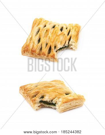 Spinach and cheese bun pastry with a bite taken off it, composition isolated over the white background, set of two different angles.