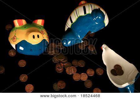 broken piggy bank spilling out pennies