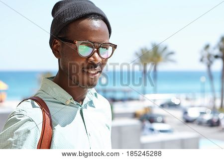 Attractive Black European Tourist With Knapsack Posing Outdoors While Exploring Sights And Locations