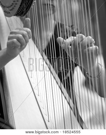 woman playing harp, detail in black and white