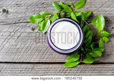 Jar Of Moisturizing Facial Cream With Leaves Top View