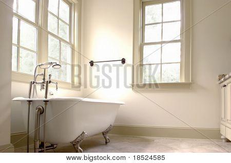 minimalist bathroom with tile floor and clawfoot tub