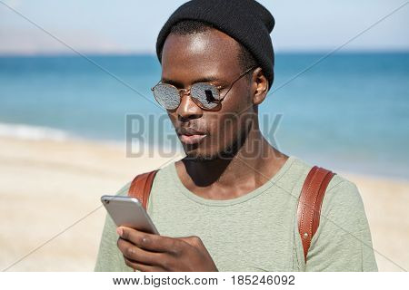 Modern Technologies, Communication, People, Lifestyle And Travel Concept. Trendy Looking Young Black
