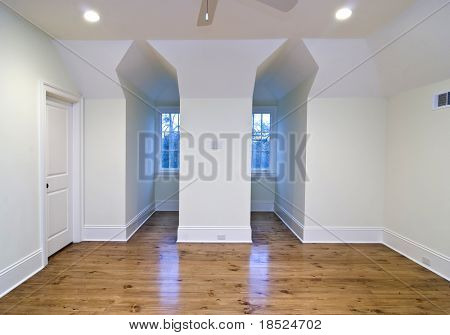 unfurnished upstairs bedroom with gable openings