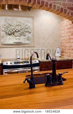 detail of kitchen with island and detailed backsplash