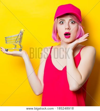 Surprised Young Woman With Shopping Cart