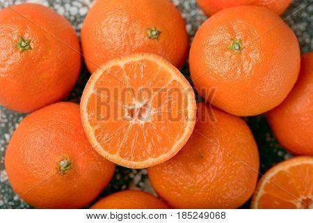 tangerine background. Pile of fresh organic orange Mandarines or tangerines