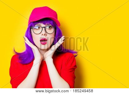 Surprised Young Woman In Cap And Glasses