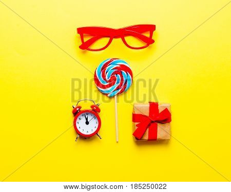 Lollipop, Glasses, Gift And Alarm Clock
