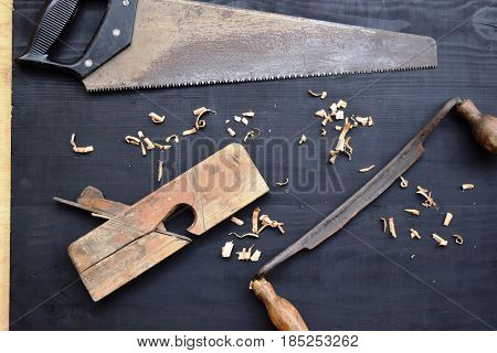 Wooden planer,  antique hand tools , tool kit for joinery, wood sawdust,