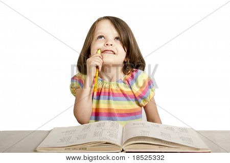 little girl studying from reading book