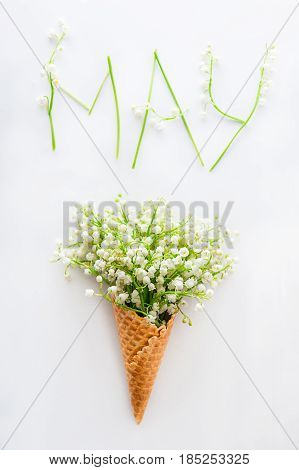 White Card With Word May - Letters Made Of Flowers And Leaves, And Bouquet Of Lilies Of The Valley (