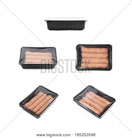 Boxed raw kebab meat on a wooden stick, composition isolated over the white background, set of five different foreshortenings