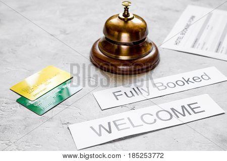 room reservation form on hotel reception stone desk background
