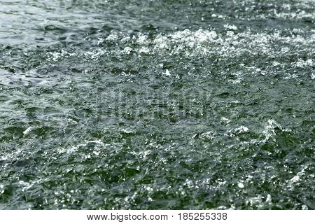 Water on a threshold of the river is rolled and rages