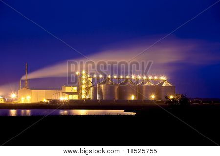 night shot of plant producing ethanol from corn