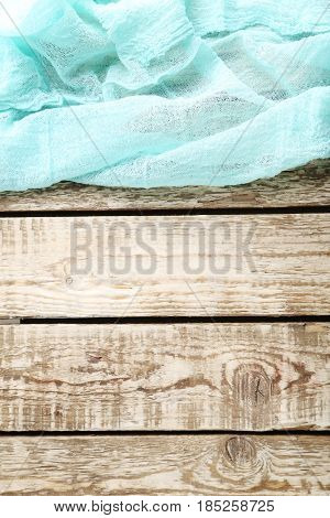 Mint Gauze Fabric On Brown Wooden Table