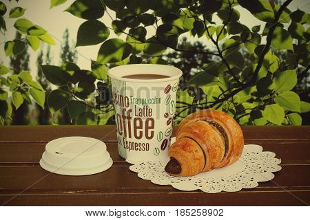 The french croissants and coffee in the nature
