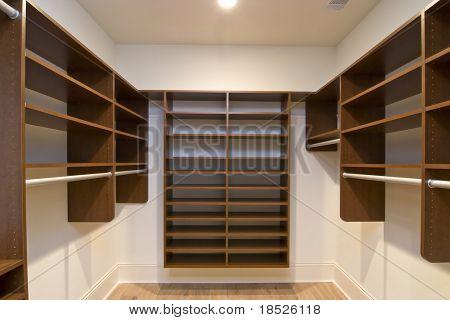 large walk in closet with modular shelves