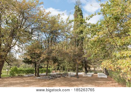 The historic graveyard between oak trees at the mission in Genadendal. Genadendal is the first mission station in South Africa founded 1738