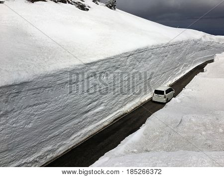 ZAO ECO LINE JAPAN - APRIL 22 2017: Car on the road in a snow tunnel in the Zao mountain range