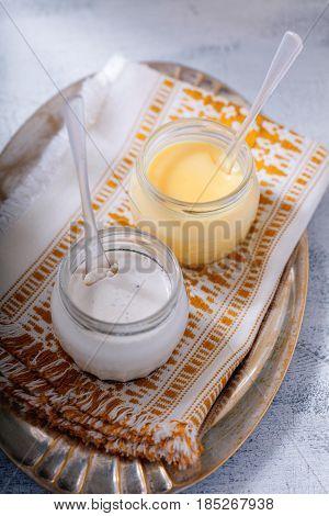 Coconut panna cotta and lemon kurd on a napkin