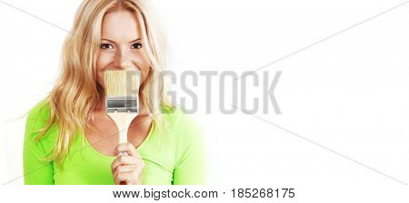 a woman with a brush against the wall