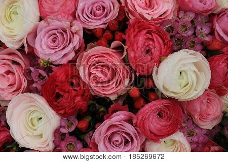 Pink roses and buttercups in a mixed pink bridal bouquet