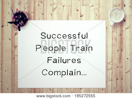 Inspiring motivation quote handwritten on a notepad successful people train failures complain. White pad paper image.