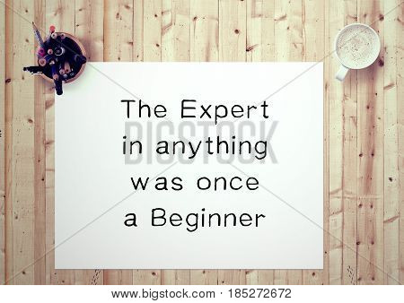 Inspiring motivation quote handwritten on a notepad the expert in anything was once a beginner. White pad paper image.
