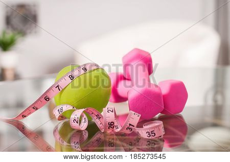 Green Apple With Measuring Tape And Dumbbells