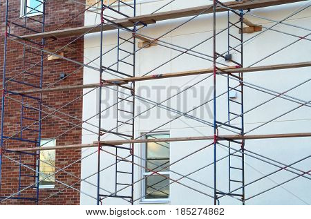 scaffold construction site brick and concrete wall renovation