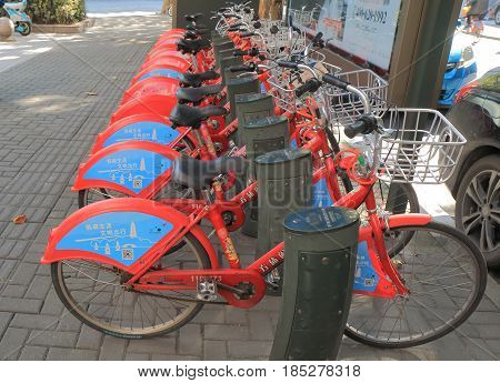 HANGZHOU CHINA - NOVEMBER 5, 2016: Bicycle share scheme in Hangzhou. Hangzhou provides the largest bike sharing system in the world, and is the first bike-sharing systems in China