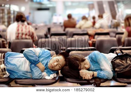 Bangkok Thailand1st June 2016 Travelers man and woman sleeping on chair seat in the lounge. While waiting to transit for international flights at Donmuang International Airport .