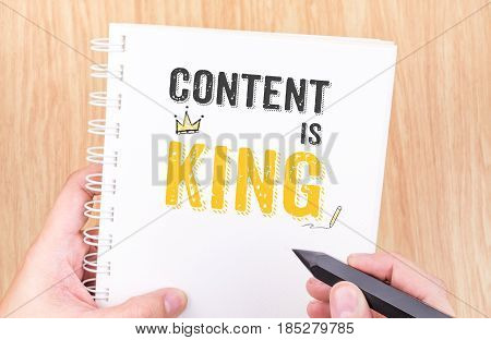 Content Is King Work On White Ring Binder Notebook With Hand Holding Pencil On Wood Table,digital Bu