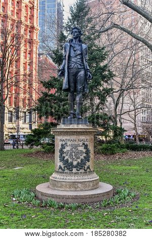 New York City - Mar 29, 2017: Monument to Nathan Hale a 13-foot standing bronze figure which directly faces City Hall and honors the last moments of the 21-year-old American Revolution era spy Nathan Hale.