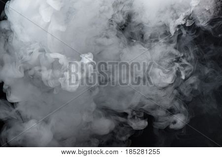 Thick White Smoke On Black Background Filling Almost The Whole Frame