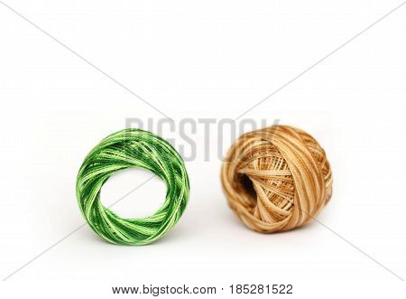 Colorful embroidery threads isolated on white background