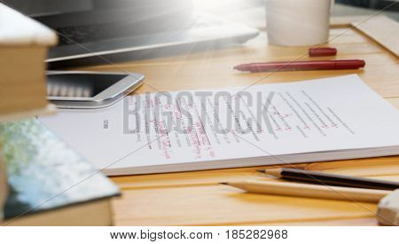 proofreading text on table in office with office supplies