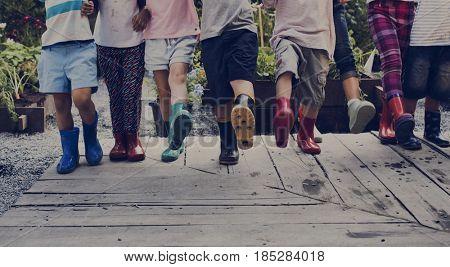 Group of kindergarten kids learning gardening outdoors