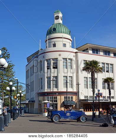 Napier - New Zeland - April 27 2017: The T&G Building Is an example of the Art Deco style of architecture from the early 1930's. In the foreground is a vintage car from the same era.