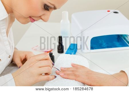 Female Beautician Making Nails.